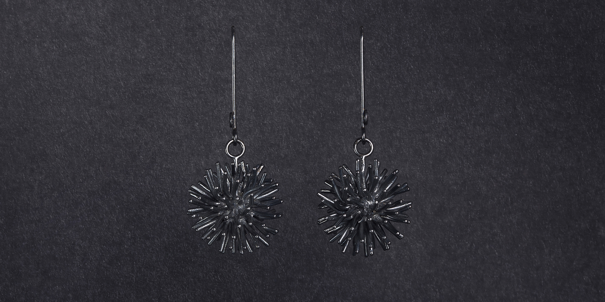 frontpage slider pompon earrings oxidized silver